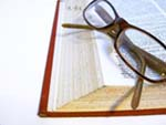 Glasses and a dictionary
